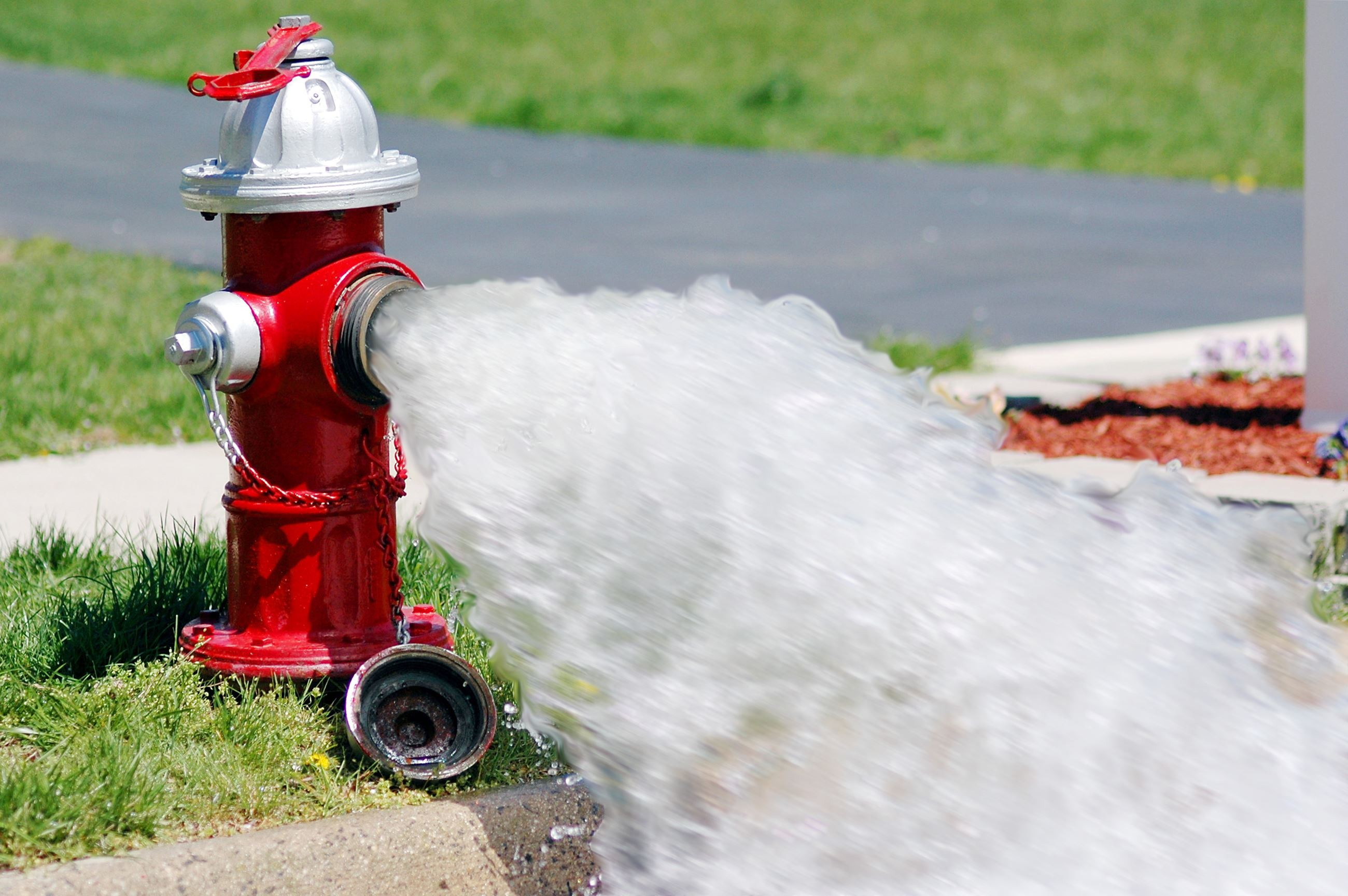 Fire-hydrant-with-water-blur